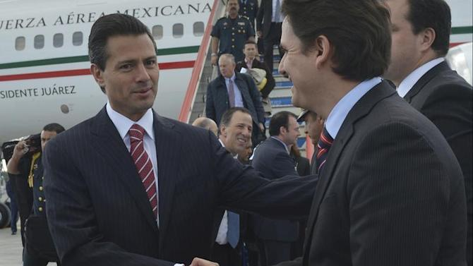 Mexico's President Enrique Pena Nieto shakes hands with officials as he arrives a day before the G20 Summit in St. Petersburg
