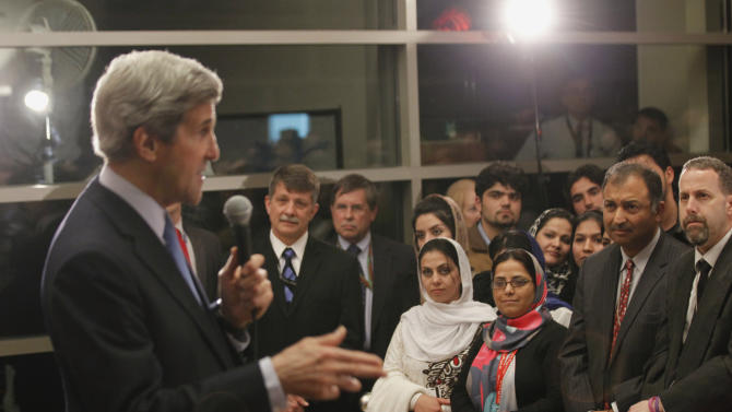 U.S. Secretary of State John Kerry talks to staff during his visit to the U.S. Embassy in Kabul, Tuesday March 26, 2013. Kerry met again Tuesday with Afghan President Hamid Karzai, a day after they put on a show of unity as they tried to end recent bickering over anti-American comments made by the Afghan leader. (AP Photo/Jason Reed, POOL)