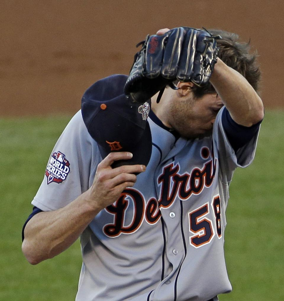 Detroit Tigers' Doug Fister wipes his face during the second inning of Game 2 of baseball's World Series against the San Francisco Giants Thursday, Oct. 25, 2012, in San Francisco. (AP Photo/Jeff Chiu)