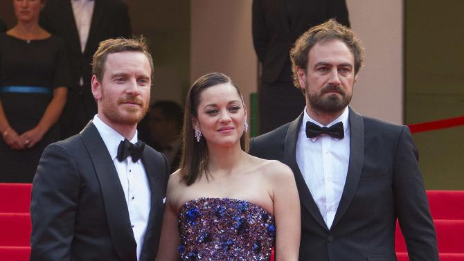"""Cast members Michael Fassbender and Marion Cotillard, director Justin Kurzel pose on the red carpet as they arrive for the screening of the film """"Macbeth"""" in competition at the 68th Cannes Film Festival in Cannes"""