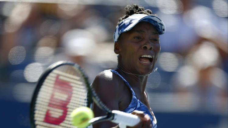 Venus Williams, of the United States, returns a shot against Sara Errani, of Italy, during the third round of the 2014 U.S. Open tennis tournament, Friday, Aug. 29, 2014, in New York. (AP Photo/Matt Rourke)