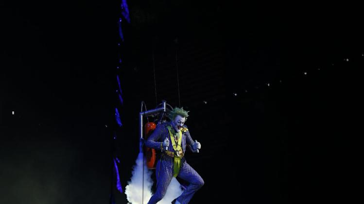 IMAGE DISTRIBUTED FOR WARNER BROS. - Batman takes on his nemesis The Joker during the L.A. Batman Live premiere on Thursday Sept. 27, 2012, at Staples Center in Los Angeles. (Photo by Todd Williamson/Invision for Warner Bros./AP Images)