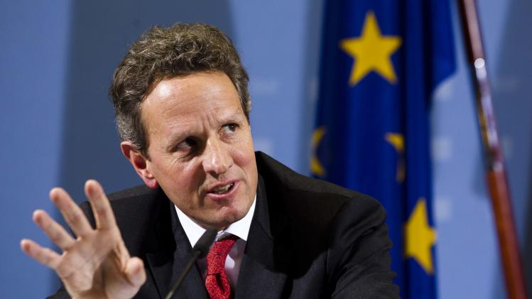 US Treasury Secretary Timothy Geithner briefs the media during a news conference with German Finance Minister Wolfgang Schaeuble after a meeting at the finance ministry in Berlin, Tuesday, Dec. 6, 2011.  (AP Photo/Markus Schreiber)
