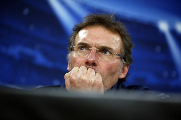 Paris St Germain's coach Laurent Blanc attends a news conference before a training session in Lisbon