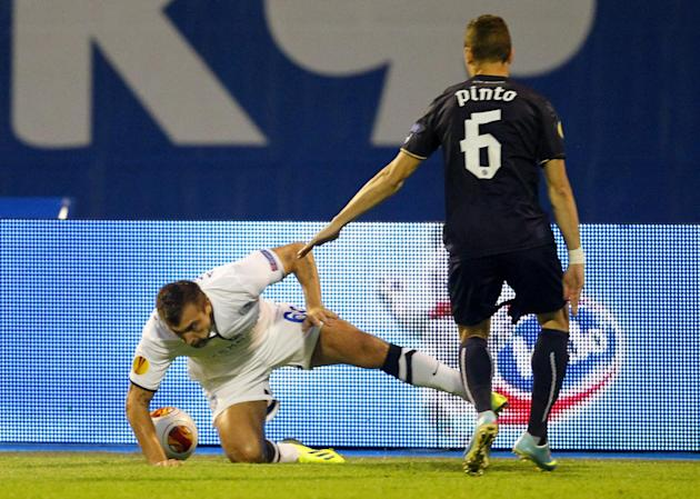 Chornomorets Odessa's  Olexiy Antonov, left, is challenged by Dinamo Zagreb's Ivo Pinto during their Europa League  group B soccer  match,   in Zagreb, Croatia, Thursday, Sept. 19, 2013