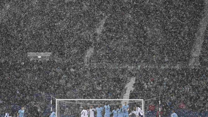 Snow falls during the English Premier League soccer match between Manchester City and West Bromwich Albion at The Hawthorns in West Bromwich