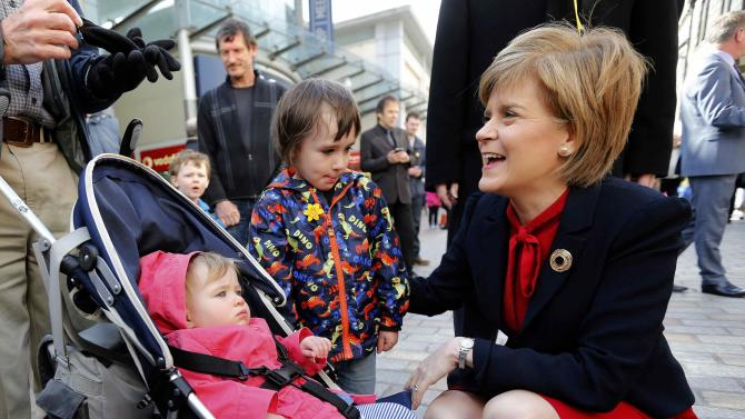 Nicola Sturgeon, leader of the Scottish National Party talks to children during an election visit to Kirkcaldy in Scotland