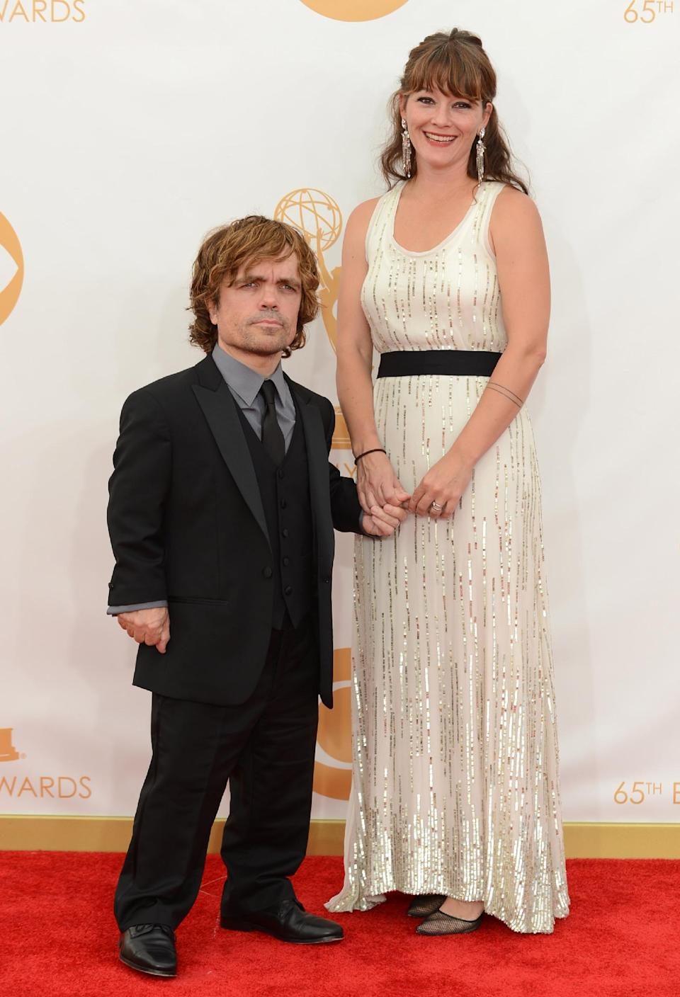 Peter Dinklage, left, and his wife Erica Schmidt arrive at the 65th Primetime Emmy Awards at Nokia Theatre on Sunday Sept. 22, 2013, in Los Angeles. (Photo by Jordan Strauss/Invision/AP)