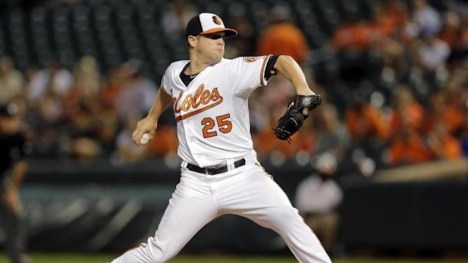 Orioles beat Reds 5-4 to extend lead in AL East