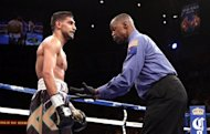 Referee Kenny Bayless gives Amir Khan from Bolton, England, a count after he was knocked down by Danny Garcia from Philadelphia, Pennsylvania, on July 14, at the Mandalay Bay Events Center in Las Vegas. Khan is considering parting company with celebrated trainer Freddie Roach following his convincing loss to Garcia in Las Vegas last weekend