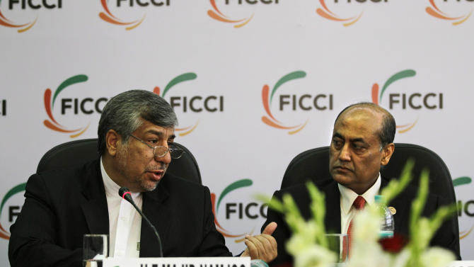 Federation of Indian Chambers of Commerce and Industry President, R. V. Kanoria, right, listens as Iranian Energy Minister Majid Namjoo speaks at an interactive business meeting with FICCI members in New Delhi, India, Wednesday, Oct. 10, 2012. (AP Photo/Altaf Qadri)