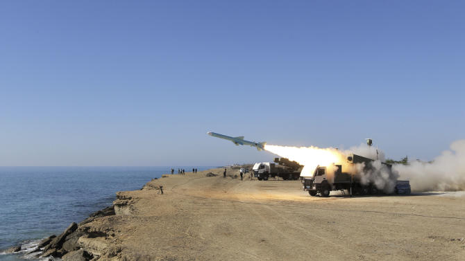 """A Ghader missile is launched from the area near the Iranian port of Jask port on the shore of the Gulf of Oman during an Iranian navy drill, Tuesday, Jan. 1, 2013. Iran says it has tested advanced anti-ship missiles in the final day of a naval drill near the strategic Strait of Hormuz, the passageway for one-fifth of the world's oil supply. State TV says """"Ghader"""", or """"Capable"""", a missile with a range of 200 kilometers (120 miles), was among the weapons used Tuesday. It says the weapon can destroy warships. (AP Photo/Jamejam Online, Azin Haghighi)"""