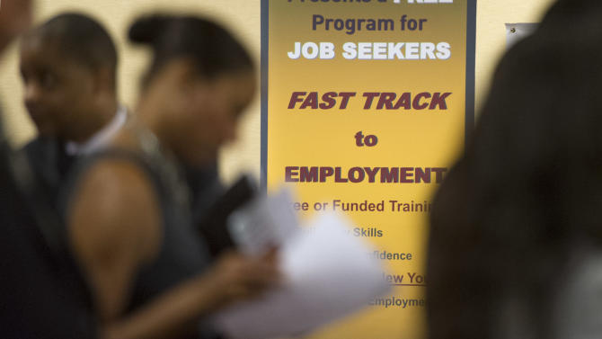 In this Thursday, May 30, 2013, photo, job seekers line up to talk to recruiters during a job fair held in Atlanta. The government reports on state unemployment rates for May, on Friday, June 21, 2013. (AP Photo/John Amis)