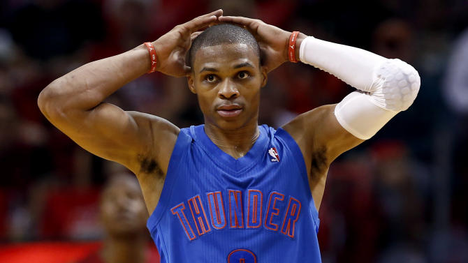 Oklahoma City Thunder's Russell Westbrook reacts during the final minute of an NBA basketball game against the Miami Heat in Miami, Tuesday, Dec. 25, 2012. The Heat won 103-97. (AP Photo/J Pat Carter)