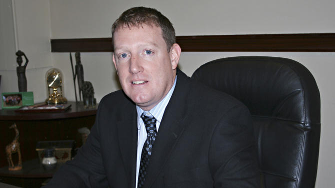 A Dec. 20, 2011 photo shows Beadle County State's Attorney Michael Moore in Huron, S. D. Moore has spearheaded charges against 34-year-old Werner Fajardo, who is accused of serving alcohol to minors and sexually assaulting three girls at a bar in Huron. South Dakota police say Fajardo exploited an outdated ordinance that allowed 18- to 21-year-olds in an establishment serving alcohol if it was designated as a dance hall. Fajardo  has been charged with six counts of rape and several counts of providing alcohol to minors at his El Cuervo bar in Huron. He has pleaded not guilty to all charges.  (AP Photo/Kristi Eaton)
