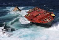 This file picture, released by Maritime New Zealand in April, shows the Monrovia-flagged container ship 'Rena' stuck on Astrolabe Reef as it is pounded by high seas off the coast of Tauranga. The Greek owners of Rena, the ship at the centre of New Zealand's worst maritime environmental disaster, agreed on Tuesday to pay up to NZ$38 million ($31 million) towards the cost of the clean-up