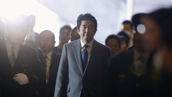 Abe walks to attend an ordinary session of parliament in Tokyo