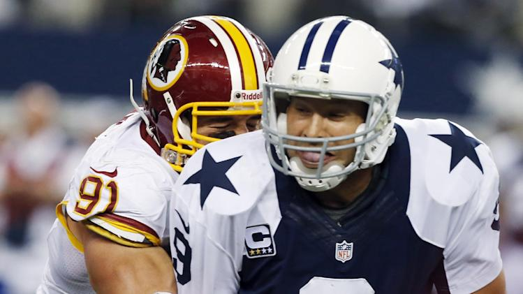 Dallas Cowboys quarterback Tony Romo (9) is sacked by Washington Redskins outside linebacker Ryan Kerrigan (91) during the second half of an NFL football game, Thursday, Nov. 22, 2012, in Arlington, Texas. The Redskins won 38-31. (AP Photo/The Waco Tribune-Herald, Jose Yau)