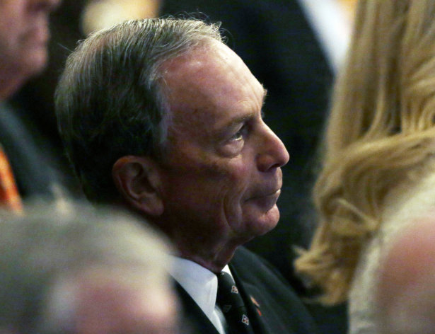 <p>               New York City Mayor Michael Bloomberg listens as New York Gov. Andrew Cuomo delivers his third State of the State address at the Empire State Plaza Convention Center on Wednesday  Jan. 9, 2013, in Albany, N.Y. (AP Photo/Mike Groll)