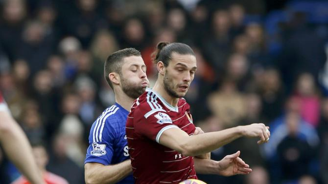 Chelsea's Gary Cahill challenges West Ham United's Andy Carroll during their English Premier League soccer match at Stamford Bridge in London