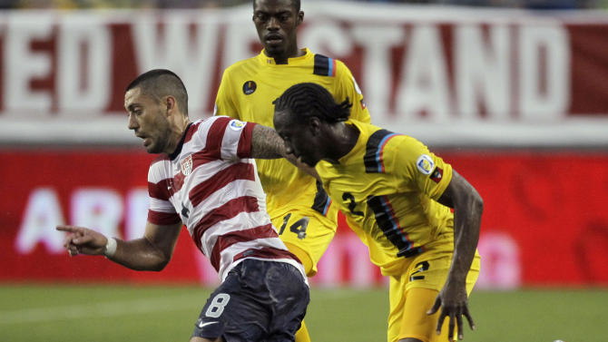 U.S. forward Clint Dempsey (8) slips between Antigua and Barbuda defenders Mark McCoy (2) and Randolph Burton (14) during the first half of a FIFA World Cup qualifying soccer game Friday, June 8, 2012, in Tampa, Fla. (AP Photo/Chris O'Meara)