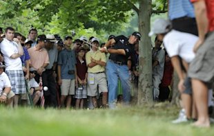Mickelson hits from the rough on the 16th hole during the first round of the 2011 U.S. Open in Maryland