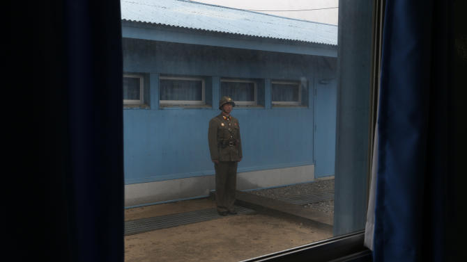 """A North Korean soldier stands guard on the demarcation line of the Demilitarized Zone that separates the two Koreas in Panmunjom, North Korea Monday, April 23, 2012. North Korea promised Monday to reduce South Korea's conservative government """"to ashes"""" in less than four minutes, in an unusually specific escalation of recent threats aimed at its southern rival.  The statement by North Korea's military, carried by state media, comes amid rising tensions on the Korean peninsula. Both Koreas recently unveiled new missiles, and the North unsuccessfully launched a long-range rocket earlier this month.  (AP Photo/Vincent Yu)"""