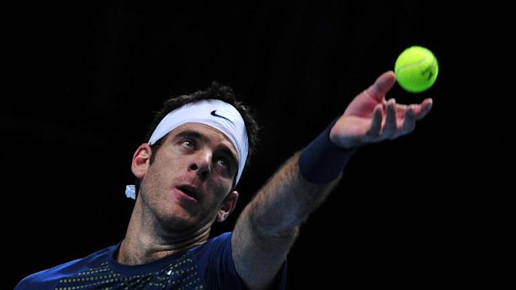 Argentina's Juan Martin Del Potro serves during the ATP World Tour Finals tennis tournament in London on November 9, 2013