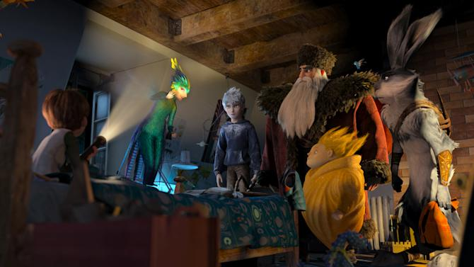 "This film image released by DreamWorks Animation shows the character Jamie, voiced by Dakota Goyo, left, as he awakens to find The Guardians, from second left, Tooth, voiced by Isla Fisher, Jack Frost, voiced by Chris Pine, North, voiced by Alec Baldwin, Sandman, and Bunnymund, voiced by Hugh Jackman in a scene from ""Rise of the Guardians.""  The 3-D computer-generated fantasy tale is based on William Joyce's book series, ""The Guardians of Childhood."" (AP Photo/DreamWorks Animation)"