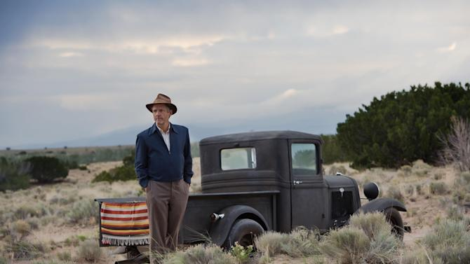 "This photo released by WGN America shows, John Benjamin Hickey as Frank Winter, in a scene from the TV series, ""Manhattan."" The show debuts 9 p.m. ET/8 p.m. CT, Sunday, July 27, 2014, on cable channel WGN America. The drama is set in a makeshift, desolate New Mexico desert community, one of several that sprang up as part of the Manhattan Project aiming to beat Nazi Germany to the bomb. (AP Photo/WGN America, Greg Peters)"