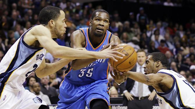 Oklahoma City Thunder's Kevin Durant (35) is pressured by Memphis Grizzlies' Mike Conley, right, and Tayshaun Prince, left, during the first half of an NBA basketball game in Memphis, Tenn., Wednesday, March 20, 2013. (AP Photo/Danny Johnston)