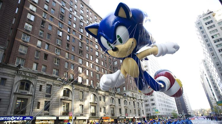 FILE - In this Nov. 22, 2012 file photo, the Sonic the Hedgehog balloon floats in the Macy's Thanksgiving Day Parade in New York. Sega says it will exclusively release the next three games starring the iconic blue critter on Nintendo platforms. (AP Photo/Charles Sykes, File)
