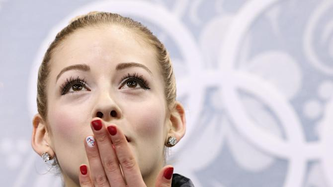 Kim wins short program, Lipnitskaia falls to 5th