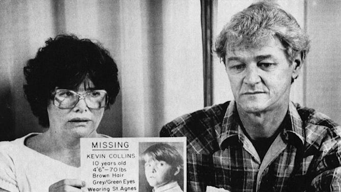 FILE - In this March 2, 1984 file photo, Ann and David Collins, parents of missing 10-year-old Kevin Collins, hold one of their posters during a news conference in San Francisco. Kevin Collins, disappeared Feb. 10, 1984 while returning home from basketball practice.  A law enforcement official tells The Associated Press that investigators were digging in the backyard and the basement of a home near the city's Haight-Ashbury district in search of evidence in Collins' disappearance Tuesday, Jan. 29, 2013. (AP Photo/Paul Sakuma, File)