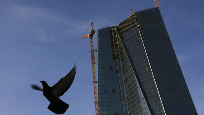 A pigeon flies next to the construction site of the new European Central Bank (ECB) headquarters in Frankfurt