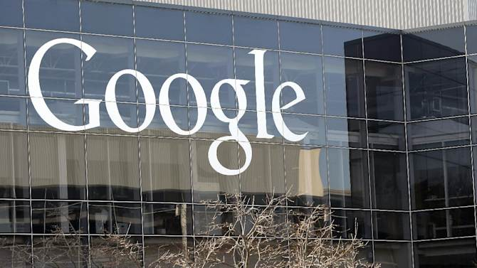 This Thursday, Jan. 3, 2013, photo shows a Google sign at the company's headquarters in Mountain View, Calif. Google is pledging to license hundreds of key patents to mobile computing rivals under more reasonable terms and to curb the use of snippets from other websites in Internet search results in a settlement that ends a high-profile antitrust probe.  (AP Photo/Marcio Jose Sanchez)