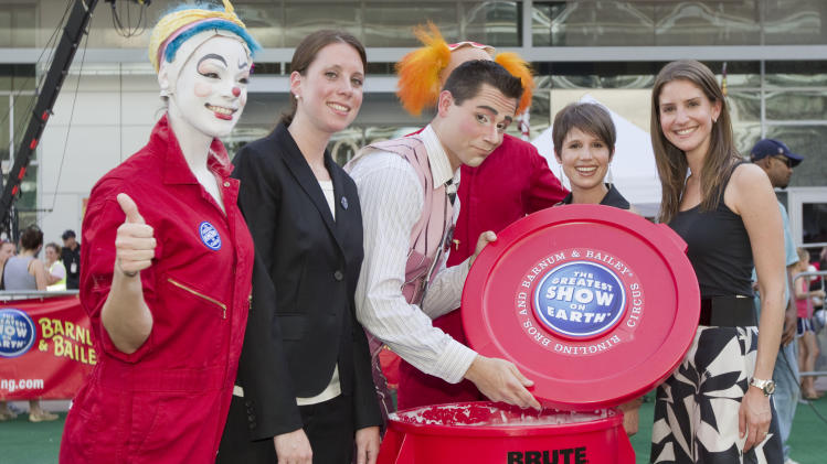 COMMERCIAL IMAGE -  Ringling Bros. and Barnum & Bailey clowns Kelli Brown and Dustin Portillo along with Guinness World Records adjudicator Sara Wilcox and Ringling Bros. producers Nicole Feld and Alana Feld inspect the pie filling before setting a new Guinness World Record for the Biggest Shaving Cream Pie Fight On Earth, Tuesday, July 31, 2012 in Dallas. (Photo by Brandon Wade/Invision for Ringling Bros. and Barnum & Bailey/AP Images)