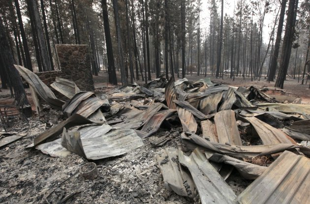 The burned remains of a home destroyed by a Ponderosa fire are seen near Manton, Calif., Monday, Aug. 20, 2012. More than 1,400 fire fighters are battling the fire that has destroyed seven homes, burned 23 square miles. The fire that started Saturday is just 5 percent contained.