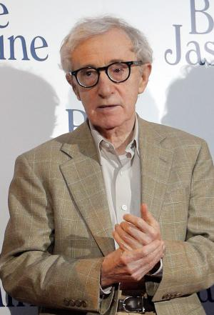 """FILE - This Aug. 27, 2013 file photo shows director and actor Woody Allen at the French premiere of """"Blue Jasmine,"""" in Paris. Allen will receive the Cecil B. DeMille Award at Sunday's Golden Globes ceremony. The writer-director famously avoids awards shows, though, and skipped those for his previous 12 Golden Globe nominations. (AP Photo/Christophe Ena, File)"""