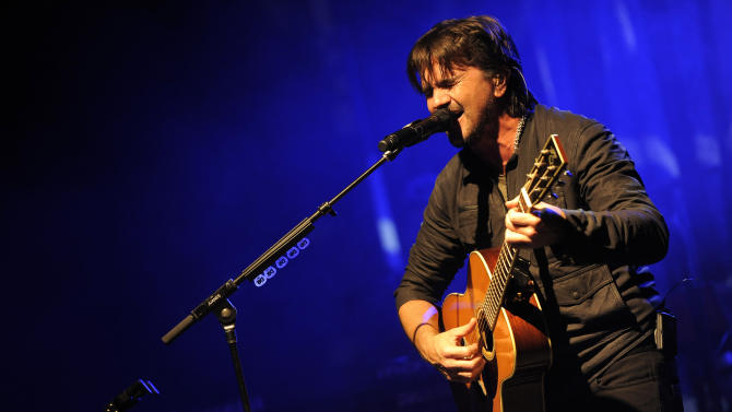 IMAGE DISTRIBUTED FOR METROPCS - Grammy award winner Juanes performs at a private concert presented by tour sponsors MetroPCS & ZTE, on Monday, February, 11, 2013 at the El Rey Theatre in Los Angeles. (Photo by Chris Pizzello/Invision for MetroPCS/AP Images)