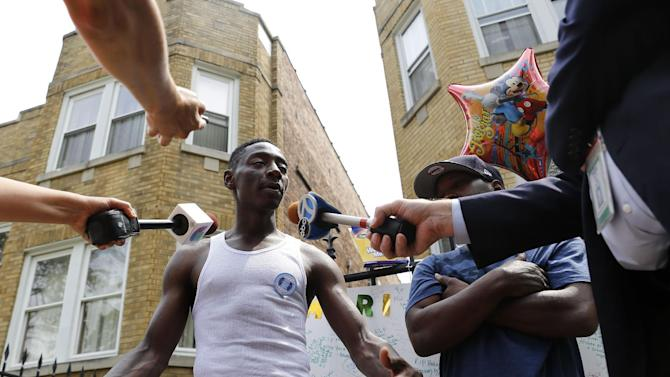Antonio Brown, father of Amari Brown, speaks with the media, Monday, July 6, 2015, in Chicago. Authorities say 7-year-old Amari Brown, who was celebrating the Fourth of July with his family, was among three people who were shot and killed overnight during a weekend outbreak of gun-related violence in Chicago. (AP Photo/Christian K. Lee)