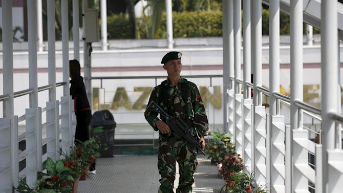 Indonesian soldier patrols on a pedestrian overpass ahead of the Asian-African conference in Jakarta