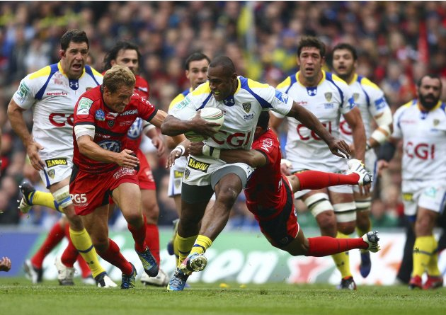 Clermont Auvergne's Fofana is tackled by Wilkinson and Armitage of Toulon during the Heineken Cup rugby tournament final at the Aviva Stadium in Dublin