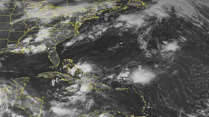 This NOAA satellite image taken Thursday, August 09, 2012 at 01:45 PM EDT shows a tropical wave approaches Hispaniola from the tropical Atlantic Ocean. This system remains at a low, 10% chance of tropical cyclone development.  Meanwhile another tropical wave kicks up more showers and thunderstorms across the Bahamas and Cuba.  Clouds over the Yucatan Peninsula show the back side of Tropical Storm Ernesto as it continues moving westward through southern Mexico. (AP PHOTO/WEATHER UNDERGROUND)