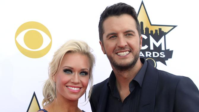 Caroline Boyer, left, and Luke Bryan arrive at the 50th annual Academy of Country Music Awards at AT&T Stadium on Sunday, April 19, 2015, in Arlington, Texas. (Photo by Jack Plunkett/Invision/AP)