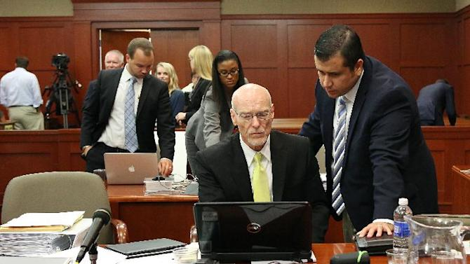 George Zimmerman, right, talks to attorney Don West during Zimmerman's trial in Seminole circuit court in Sanford, Fla. Wednesday, June 26, 2013. Zimmerman has been charged with second-degree murder for the 2012 shooting death of Trayvon Martin. (AP Photo/Orlando Sentinel, Jacob Langston, Pool)
