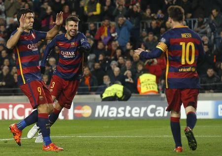Barca's Suarez and Messi hit doubles in Roma rout
