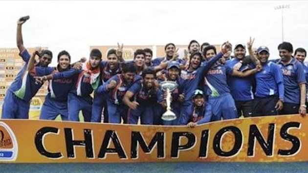 Indian players pose for photos as they celebrate their victory over Australia in the the 2012 ICC U19 Cricket World Cup final in Townsville, Australia