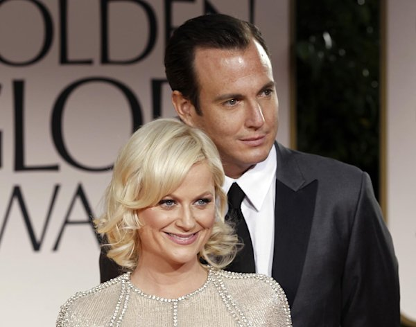 FILE - This Jan. 15, 2012 file photo shows actors Amy Poehler, left, and Will Arnett arriving at the 69th Annual Golden Globe Awards in Los Angeles. The couple is separating after 9 years of marriage, their publicist Lewis Kay confirmed Thursday, Sept. 6. Poehler and Arnett have two young sons, 3-year-old Archie and 2-year-old Abel. (AP Photo/Matt Sayles, file)