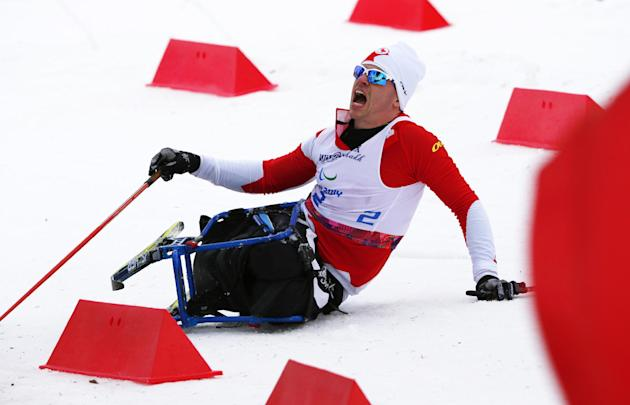 Sebastien Fortier of Canada crashes during the men's 15-kilometer cross country ski sitting event at the 2014 Winter Paralympics, Sunday, March 9, 2014, in Krasnaya Polyana, Russia